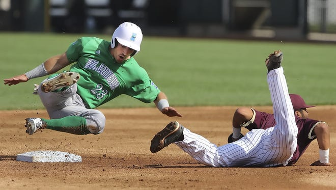 The Islanders' Zack Gibson (L) tumbles over second base after being tagged out by Texas State's Jonathan Ortega (right) during the Kleberg College Classic last year at Whataburger Field. The Islanders announced their 2017 schedule and will play Texas A&M and Texas this season.
