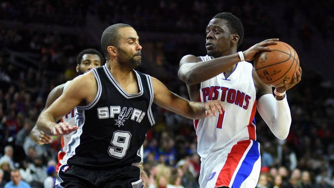 Pistons guard Reggie Jackson drives to the basket as Spurs guard Tony Parker defends during the third quarter of the Spurs' 103-92 win at the Palace on Feb. 10, 2017.