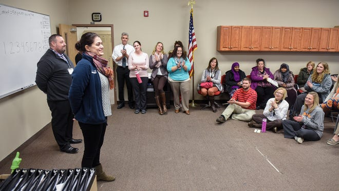 STRIDE Academy Board Chair Sara Fromm gives good news to staff members during a meeting at the academy after school Nov. 16, 2017, in St. Cloud. The academy learned that the school's authorizer approved the school's request to transfer to a new authorizing agency.