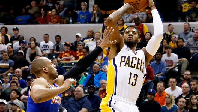 Indiana Pacers forward Paul George (13) takes a shot against New York Knicks guard Arron Affalo (4) at Bankers Life Fieldhouse.