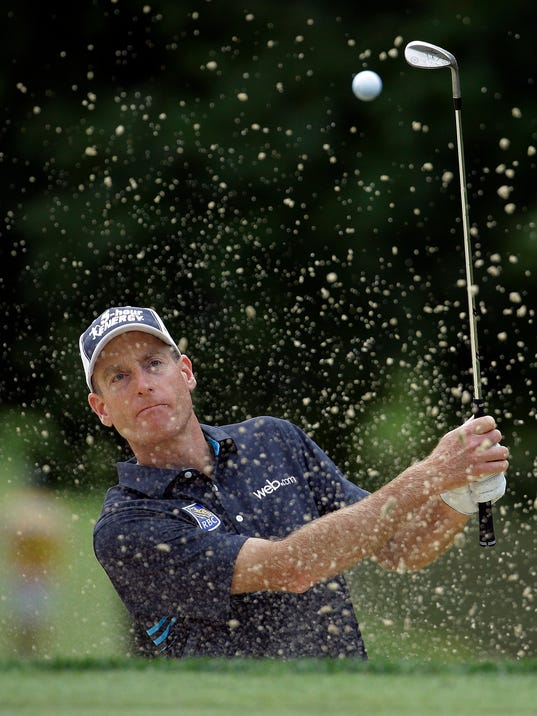 Jim Furyk hits out of the bunker on the 11th hole during the first round of the PGA Championship golf tournament at Valhalla Golf Club on Thursday, Aug. 7, 2014, in Louisville, Ky. (AP Photo/Jeff Roberson)