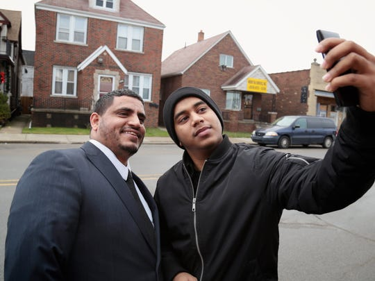 Mohammed Aziz, 21, of Hamtramck, takes a selfie with newly elected city councilman Saad Almasmari, 28, of Hamtramck, on Wednesday, December 23, 2015, in Hamtramck, MI.