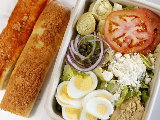 The Greek salad comes with tomato, artichoke, capers,