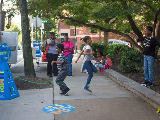 Jump rope boxes like this one can turn a city sidewalk into a play area for kids to keep active and healthy.
