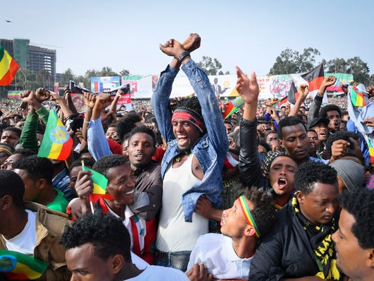 Supporters cheer for Ethiopian Prime Minister Abiy