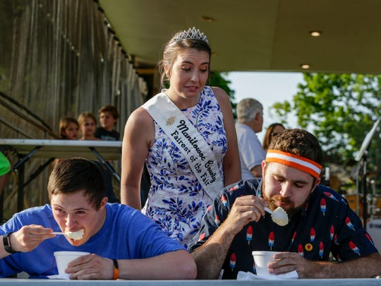 FILE - Manitowoc County Fairest of the Fair Emily Hutterer watches participants in the sundae-eating contest attack their ice cream sundaes during Sundae Thursday at Central Park in Two Rivers on June 28, 2018.