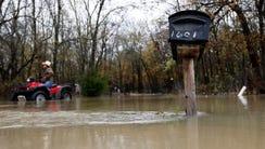 High water surrounds a mailbox near Malloy Bridge Road