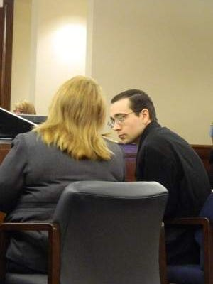 Joshua Starner consults with his attorney Sherri Phillips during jury selection Monday.
