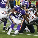 Minnesota Vikings running back Adrian Peterson (28) is stopped by Chicago Bears linebacker John Timu (53) and outside linebacker Sam Acho (49) during the second half of an NFL football game Sunday in Minneapolis.
