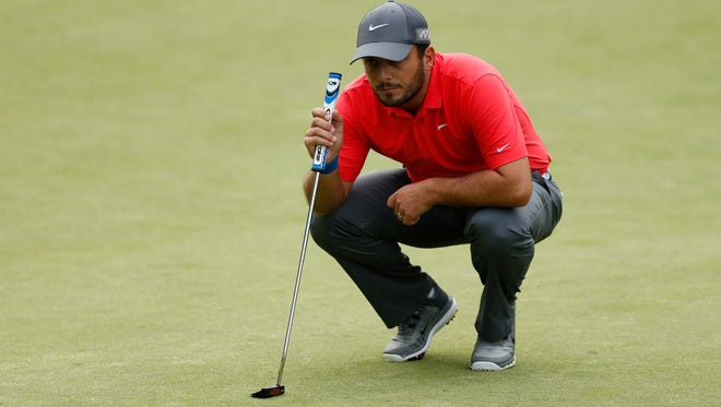 Italy's Francesco Molinari lines up a putt during the third round at the BMW PGA Championship.