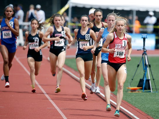 With No.8, Caroline Timm of Lourdes runs in the Girls