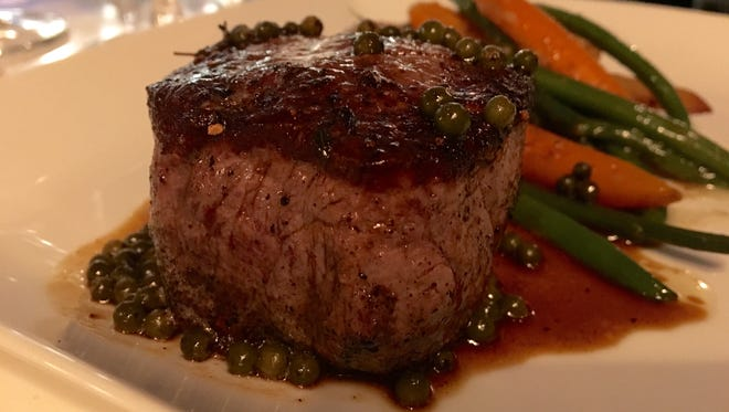 A perfect filet mignon topped in a green pepper demi from Azure.