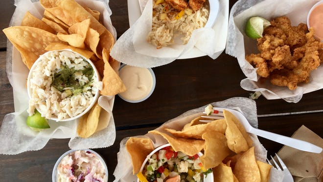Cracked conch, top right, ceviche, avocado-crab dip and grilled fish from Key Lime Conch Shack on Fort Myers Beach.