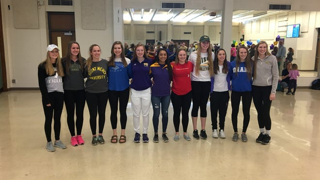 Iowa City West's fall Signing Day class. From left to right: Skylar Ryan, Aubrey Sowers, Gabi Delsing, Maddie Fay, Emma Norris, Taleah Smith, Melanie Housenga, Emily Halverson, Jordan Amelon, Madi Ford and Ali Tauchen. Nov. 11, 2016.