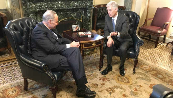 Senate Minority Leader Chuck Schumer, D-N.Y., meets with Supreme Court nominee Neil Gorsuch at the U.S. Capitol on Jan. 7, 2017.
