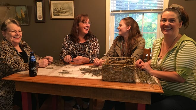 Nikki Narduzzi (right) sits at her dining room table in her Staunton home with her grandmother Diana Andes Solomon, Aunt Donna Graber and daughter Maya Simmons on Thursday, Oct. 26, 2017. Narduzzi, who has Crohn's disease, advocates for cannabis oil and medical marijuana policy reform in Virginia.