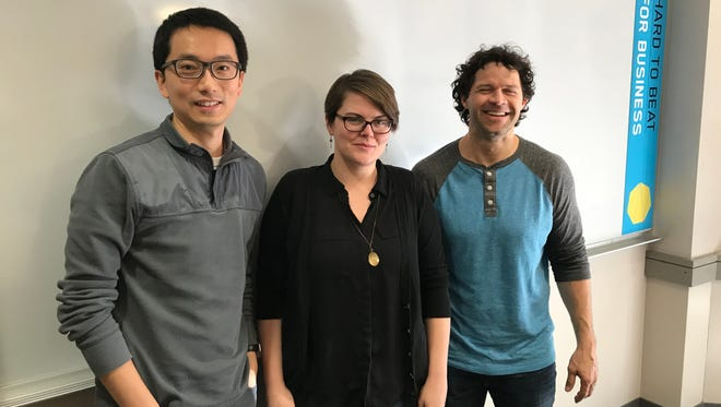 Kristina Gavin Bigsby, flanked by her University of Iowa professors Kang Zhao (left) and Jeff Ohlmann, came up with a way to predict which college a football recruit will choose by monitoring their Twitter behavior.