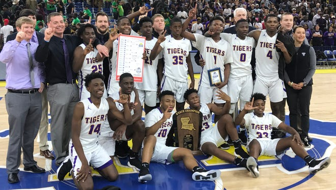 Coach Josh Brown and the Simsboro Tigers celebrate their 2018 Class B state championship after beating Zwolle 67-51 on Saturday in Burton Coliseum.
