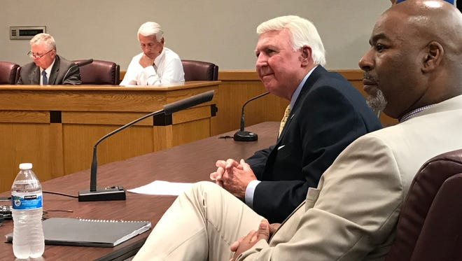 Greenville County interim sheriff Johnny Mack Brown, center, fields questions from Greenville County Council members on Tuesday, May 8, 2018, at County Square along with Chief Deputy Marcus Davenport, right.