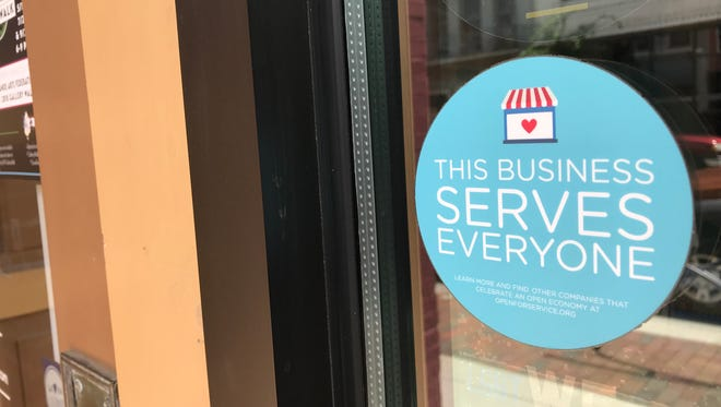 Open for Business, an Indianapolis-based nonprofit, started distributing these stickers in 2015 to businesses committed to serving customers no matter their  sexual orientation, race or political views. The stickers are on 50,000 businesses across the United States.