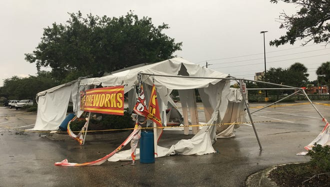 A strong wind gust carried a fireworks tent 200 feet across a Walmart parking lot, injuring three people Tuesday night.