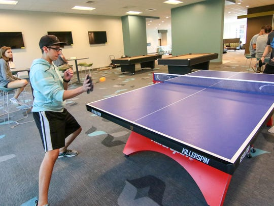 Jared Saleeby, left, a freshman from Myrtle Beach, plays table tennis in the G. Ross Anderson Jr. Student Center.