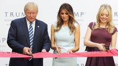 Donald Trump, Melania Trump and Tiffany Trump cut the