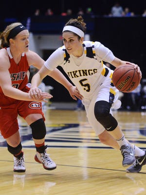 Augie's Sophie Kenney dribbles past St. Cloud State's Betsy MacDonald in Friday's doubleheader at the Sioux Falls Arena, Jan 15, 2016.