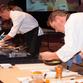 Local chefs prepare their signature dishes.