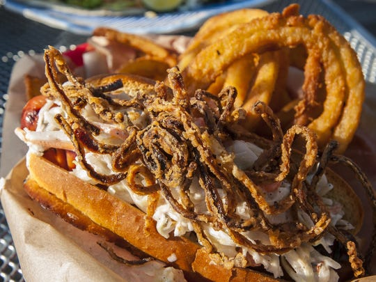 The Splash Weiner, with a McKenzie hot dog, Jamaican slaw and crispy onions, at Splash at the Boathouse on the waterfront in Burlington on June 18.