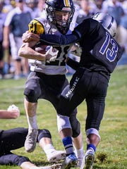 Johnson Central's Dylan Preston runs for a touchdown past Moore's JoaiahTaylor during the game played at Moore Traditional School, Friday, September 15, 2017.