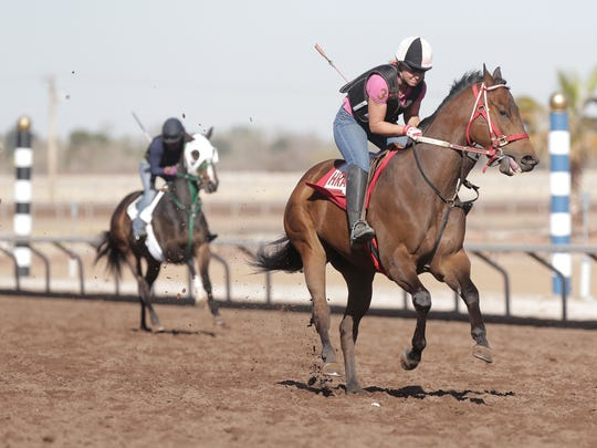 Horses who have been removed from quarantine at Sunland Park Racetrack & Casino work out. This year's Sunland Derby has been canceled, however, due to the recent horse virus scare.