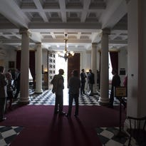 Legislators, lobbyists and others gather in the lobby of the Statehouse in Montpelier on May 15. House and Senate members will gather at the Statehouse on Tuesday for a special session on the budget.