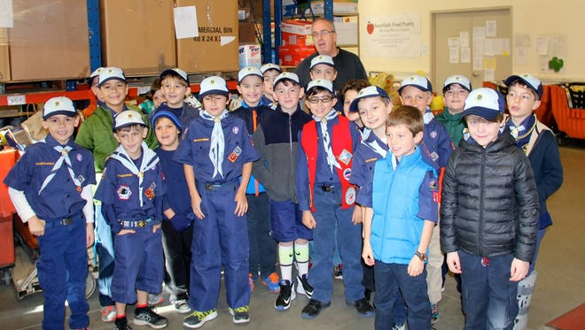 Cub Scouts from Mendham's Pack 133 donate almost 500 pounds of food to the Interfaith Food Pantry in time for the Thanksgiving holiday