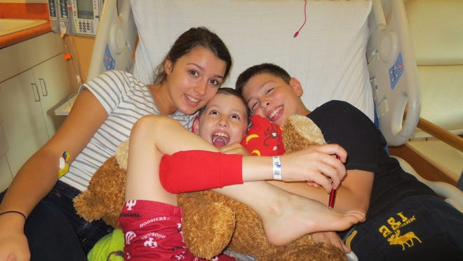 Ali and Matthew Klein clown around with their little brother Jack (middle), in the hospital early in his treatment for lymphoma.