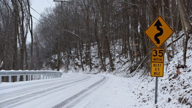 Snow covers Poplar Creek Road at McCrory Lane Tuesday morning in the Bellevue area.