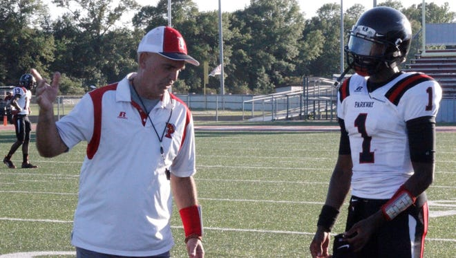 Parkway quarterback Justin Rogers listens to his coach, David Feaster, during a spring scrimmage at Ouachita Parish.
