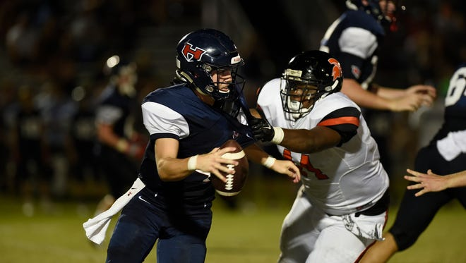 WH Heritage' s Austin Gunter, 4, is sacked  by Stratford's Zyshaun Simmons (44) during week 5 of High School Football on Friday, September 16.