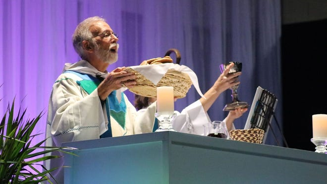 """The Rev. Gladstone B. """"Skip"""" Adams III, retiring 10th bishop of the Episcopal Diocese of Central New York, presides at a Communion service Oct. 22 at his farewell celebration."""
