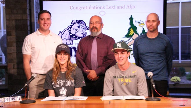 Tenafly's Lexi DelGizzo (seated, left) and Aljo Sujak recently accepted scholarship offers. Standing are (from left) track coach Dave Burns, assistant track coach Ray Belarmino and assistant baseball coach Andy Escala.