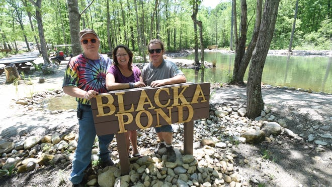 Also husband and wife, owners Garland Eutsler and Carolynn Rubino stand with brother Chris Eutsler at the newly created fishing pond, named Blacka Pond, at Shenandoah Acres Family Campground on Thursday, May 18, 2017.  With the dedication scheduled for this Saturday, the pond is named after the Blacka family which opened the Campground in 1935 and operated for 70 years.