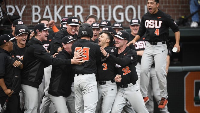 OSU players mob Jack Anderson (No. 29) after his home run in the first inning of the Beavers' victory over Yale in the Corvallis Regional at Goss Stadium on June 3, 2017.