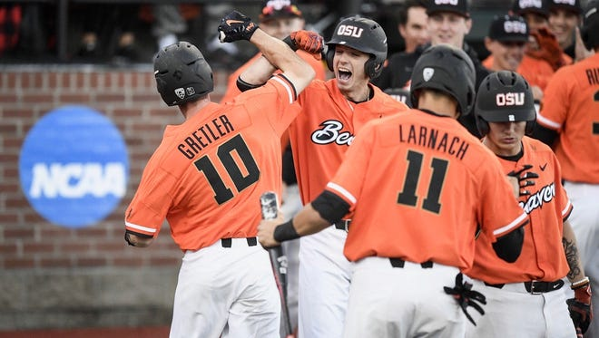 Oregon State third baseman Michael Gretler is greeted by teammates after hitting a three-run homer in the third inning against Yale at Goss Stadium on June 4, 2017.
