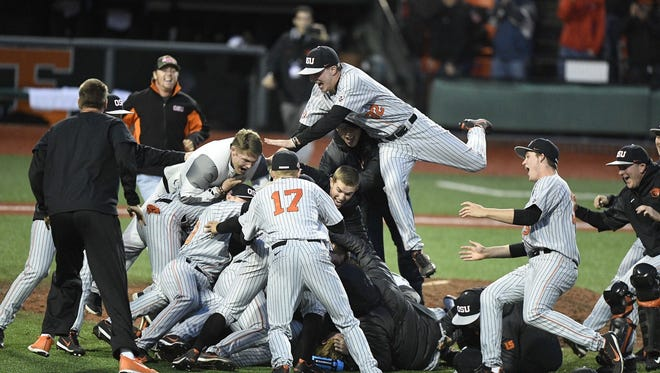OSU players celebrate after defeating Vanderbilt 9-2 to clinch the Corvallis Super Regional at Goss Stadium on June 10, 2017.