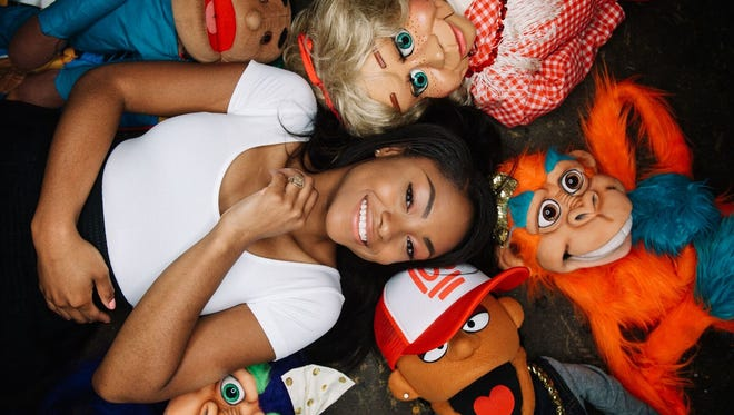 Cincinnati's Megan Piphus is surrounded by her cast of puppet characters. She acquires properties and is a professional ventriloquist.