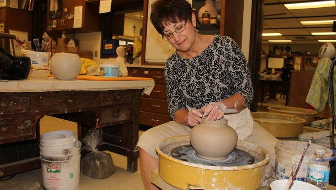 Pat Reiher, art teacher at SMSA for 33 years, demonstrates throwing a pot on the potter's wheel.