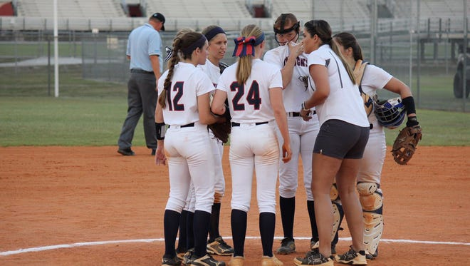 Estero infielders hold a conference during a tense moment last year. The Wildcats went 21-6 and won a district championship last year, but they're looking for more in 2018.