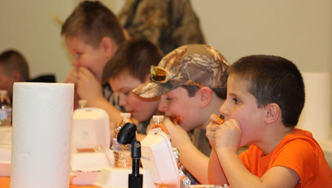 Calob Patterson, JT Moore, Ryan Cornelison and Christian Stroup compete in the junior Atomic Wings Challenge during the recent eighth annual Tri-County Wild Game Dinner.