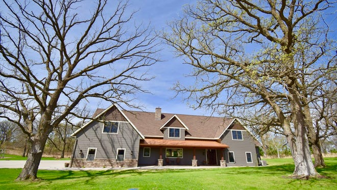 This six-bedroom, 5,600-square-foot house sits among 40 acres of wooded property.