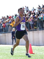 Kirtland Central's Kashon Harrison sprints to the finish line in the 4A boys state cross-country championship meet on Nov. 6 in Albuquerque.